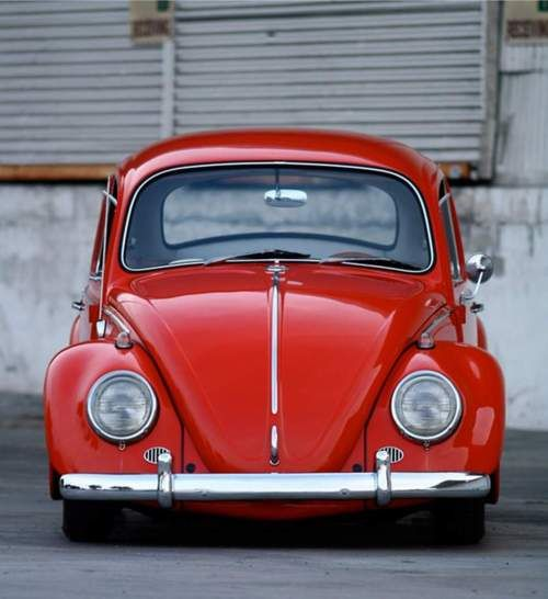 Red VW Beetle -- just like mine from high school. Didn't know how cool that car was then. Would LOVE to have it now!