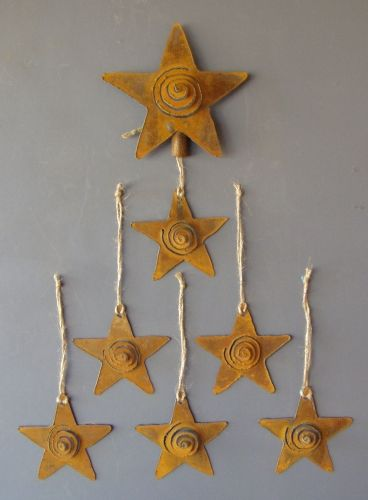 Tree Topper and Star Ornaments by Christopher Crooks Metal Art give a rustic look to the tree.