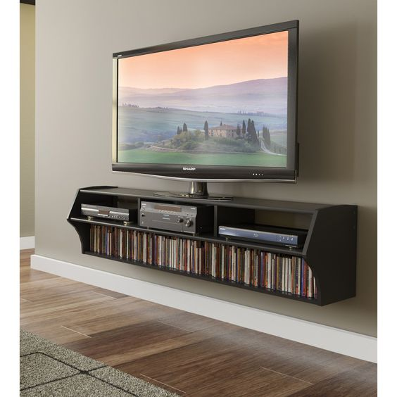 An elegant way to display your television, this modern floating TV stand. Ideal for use in small spaces, this stand features a wall-mount bracket, which makes installation easy, and it has several shelves to keep all of your media organized.