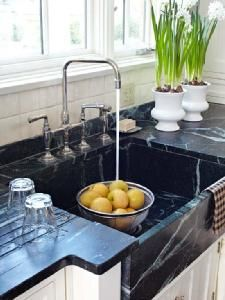 These soapstone countertops have definitely been oiled because you can see all the white streaks and markings throughout them. It gives a more stylish look you'll want to see in your kitchen.