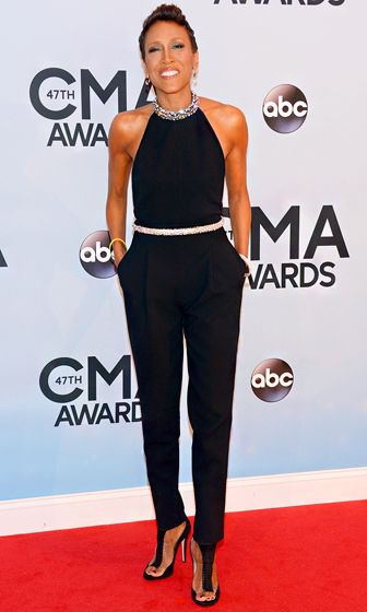 Robin Roberts wears a sleeveless black jumpsuit with a bedazzled belt and neck line to flaunt her physique.