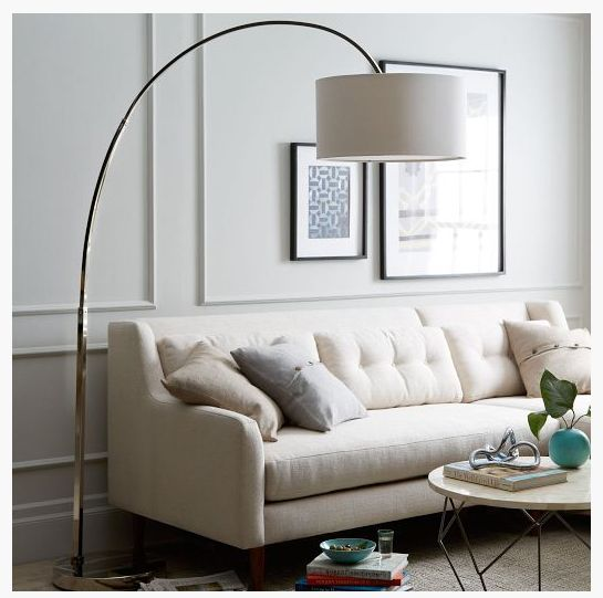 Sleek large profile curved arm lamp locate behind or for Next large curved arm floor lamp