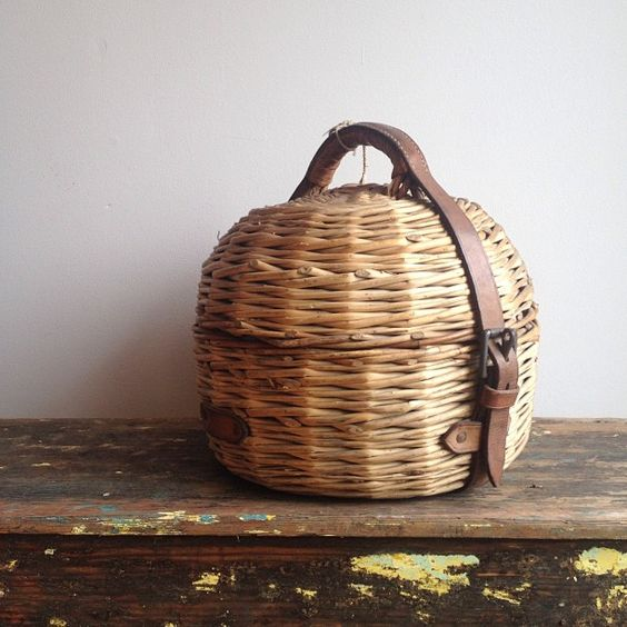 Beautiful old basket for carrying a curling stone