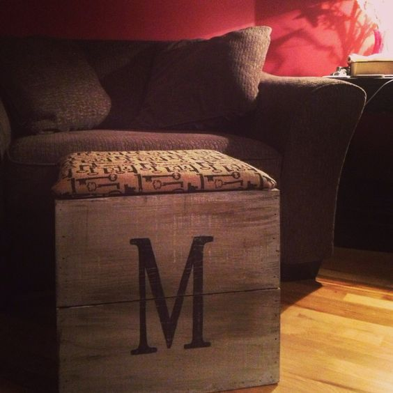 Monogrammed planter turned ottoman with storage.