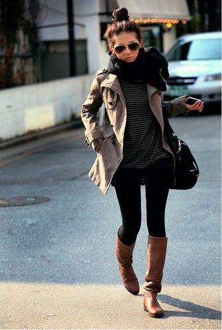 black skinny jeans, riding boots, a striped tee, a trench coat, and a circle scarf.