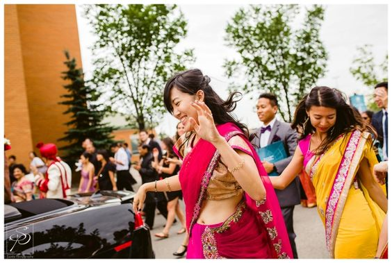 Wedding guests dancing during grooms Barat before the East Indian Wedding ceremony. For more multicultural wedding, check out our blog: www.sujataphotography.com/blog