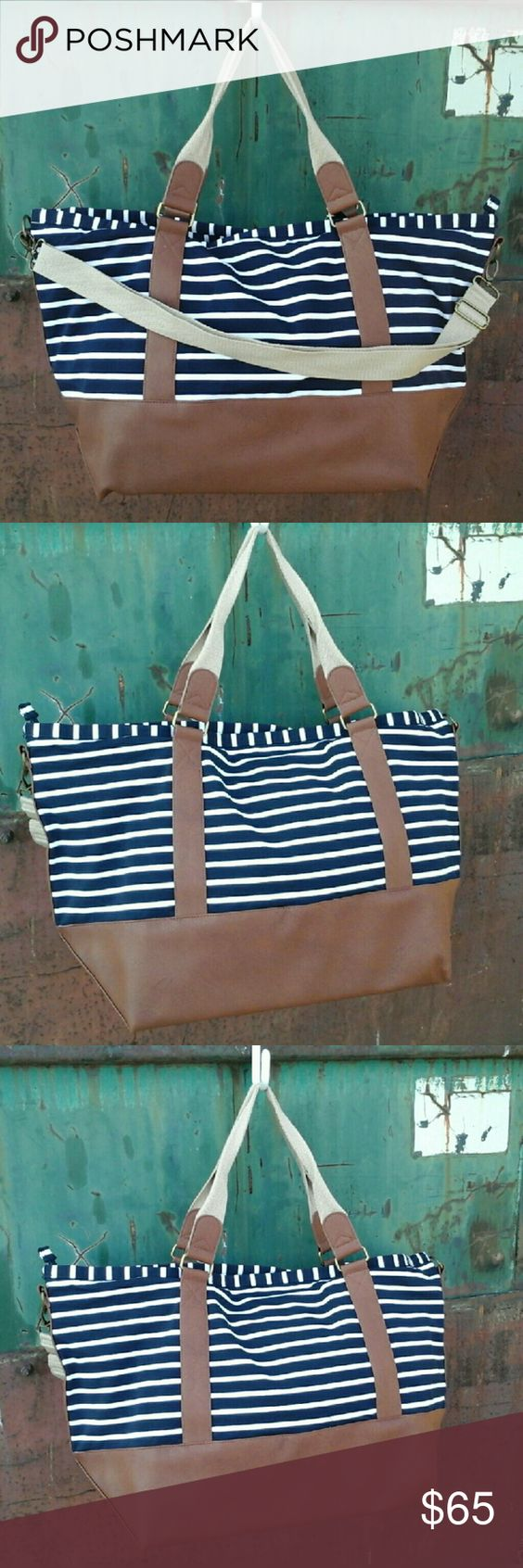 "Stripe Weekender Bag Navy, white, cognac weekender. Rolled handles with 11"" drop. Canvas shoulder strap adjusts to 24"". Polka dot fabric interior with 1 zip pocket.   Size: 19"" x 11"" x 14""  NO Trade / NO Paypal Bags Travel Bags"