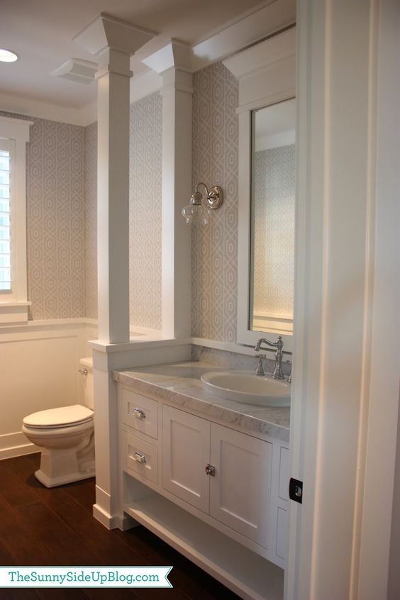 Division Detail Between Toilet And Vanity Half Wall With Columns And Wainscot Trim Continuing