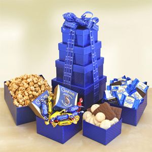 Tower of Kosher Treats $54.99  Send a tower of delectable kosher treats! This sky-high collection of treats includes caramel popcorn, Guylian chocolates, chocolate covered graham crackers, Snickerdoodle cookies and Ghirardelli chocolate squares.  http://kellyoyler.labellabaskets.com