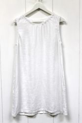 Linen Tunic Dress with Side Pockets (white)Sleeveless linen tunic dress is a perfect wardrobe essential. Can be worn on its own or over shorts, jeans, leggings or capris. Flattering, practical and pretty. It will keep you cool on the hottest sunny day or a great piece for layering - add a t-shirt underneath or cardigan or jumper over the top ad this will see you all the way through the year. We love to add a long necklace or a scarf for a bit of extra style. This tunic is extremely popular…