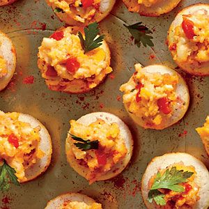 A trio of cheeses—ricotta, sharp Cheddar, and pepper Jack—make up Ricotta Pimiento Cheese. Serve Ricotta Pimiento Cheese as an appetizer over Cornmeal Tarts, crackers, or vegggies.