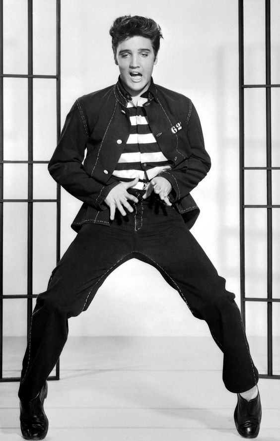 Elvis  JAIL HOUSE ROCK! Elvis could really dance to this music! I love this picture because it shows how talented he was not only at singing, but also at dancing! :)