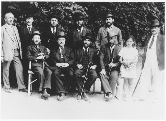 Leaders of the Sighet Jewish community. Those pictured include Mr. Hershkovich (seated far left), Mr. Klein (seated second from left), Mr. Yacobovich (standing far right), and Mr. Jahan (standing second row, right). Photograph taken ca. 1928-1930.
