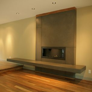 i like the long rectangular fireplace floating on the wall. Black Bedroom Furniture Sets. Home Design Ideas