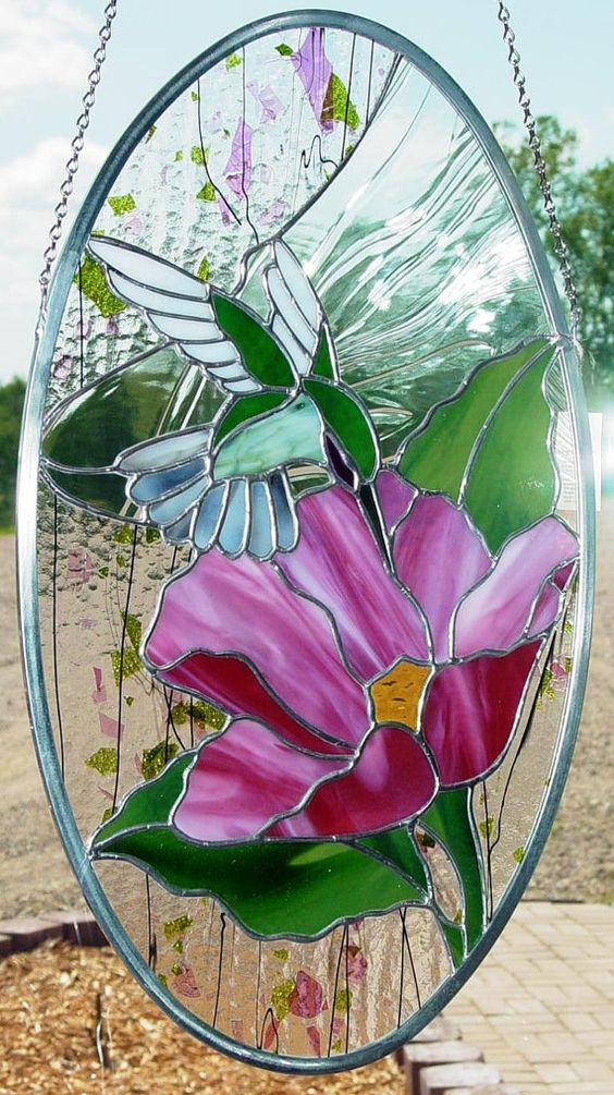Stained Glass Hummingbird and flower, made in the Tiffany copper foil method with Spectrum and Bullseye glass. A striking piece!    Measures approx. 12