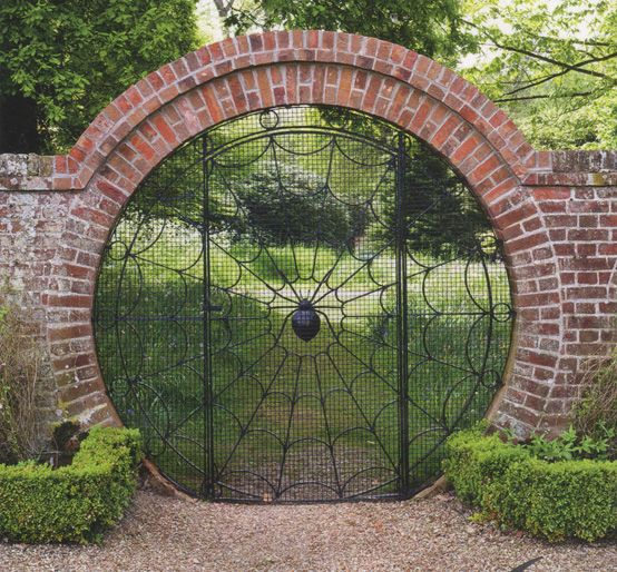 This is a very nice rounded wrought iron (framed with brick) garden gate: Hoveton Hall Gardens: