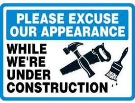 Pardon our appearance while we're under construction. @Christine Reed I can totally see this working. Black tshirt, messed up hair, and this sign. We might even be able to make it an iron-on...