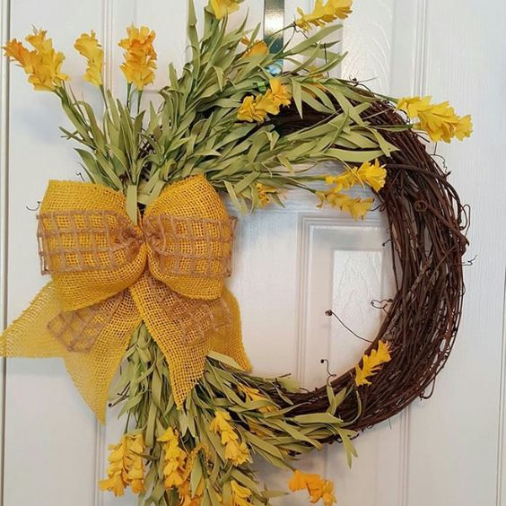"""18"""" covered Grapevine with bright fun yellow flowers, and big yellow bow."""