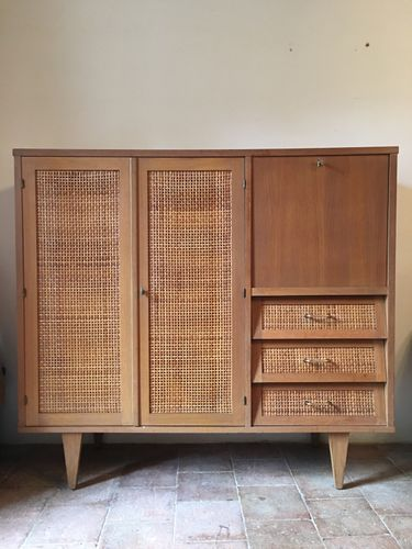 This Dresser With Light Braided Rattan And Gilded Oak Stands On Slender Triangular Feet On The Left Decoracion De Muebles Muebles Rattan Mobiliario