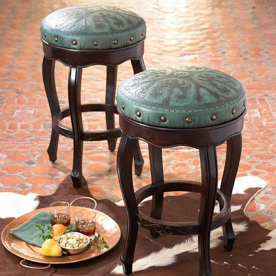 Add a dash of color to your rustic chic bar with these backless bar stools topped with tooled turquoise leather that are meticulously chiseled and carved by hand. | King Ranch Saddle Shop