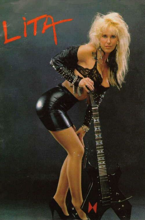 This was the classic sexy Lita Ford pinup with a tight black leather skirt, a revealing black top, an electric guitar and an erotic pose. I can't count how many magazine ran prints of this.