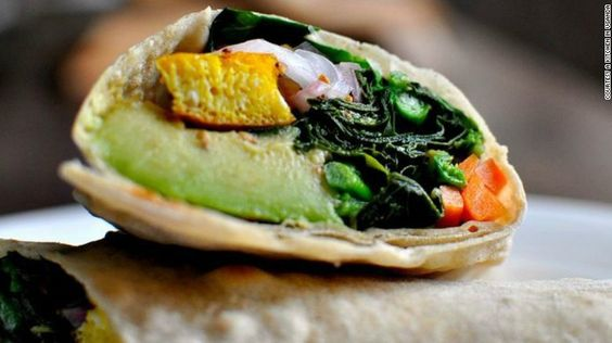 """The Rolex, a rolled chapati containing a fried egg and vegetables, is wildly popular in Uganda, but little known outside the country. """"Rolex is popular because it is a cheap filling meal that can be found on almost every street,"""" says <a href=""""https://akitcheninuganda.com/"""" target=""""_blank"""">Ugandan food blogger Sophie Musoki</a>."""