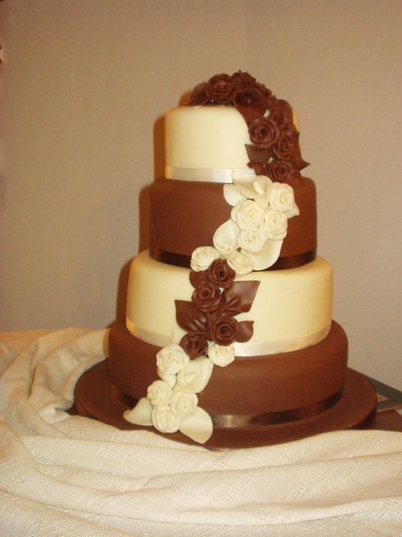 Working at the bakery I have to say this is the cake I'm most proud of. It definitely taught me patience as I had to make a lot of flowers and working with chocolate was a nightmare in summer!