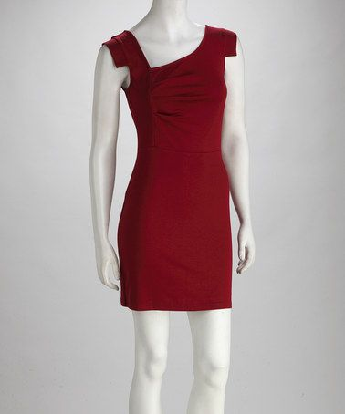 This frock features a square neckline and uniquely cut sleeves. Pair with strappy sandals for bright, unbeatable style.
