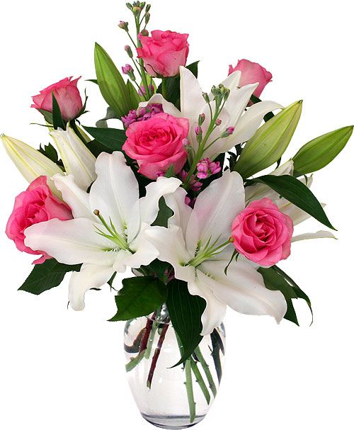 Share what has been so freely given, with this gorgeous vase arrangement of white lilies and 1/2 dozen pink roses, with delicate pink blossoms. Description from canadaflowers.ca. I searched for this on bing.com/images: