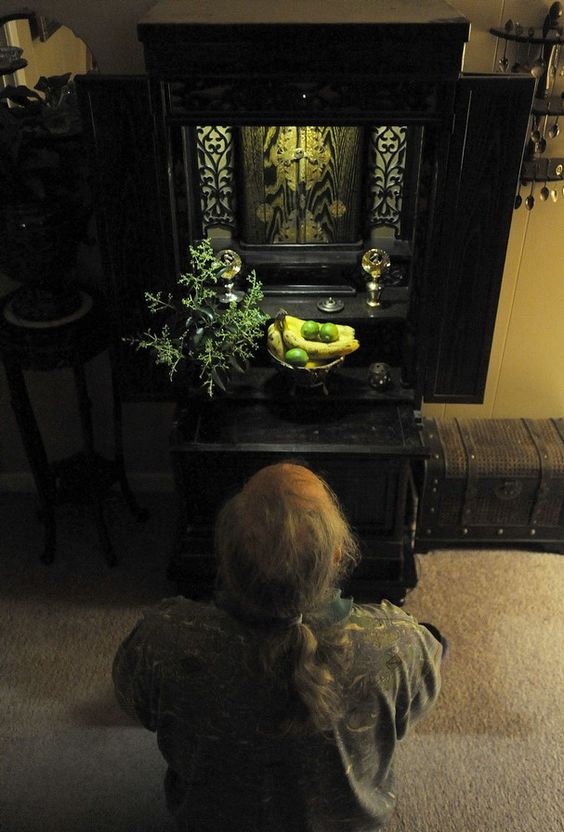 Buddhist Altars In The Home While Kneeling In Front Of His Butsudan A Buddhist Altar At His