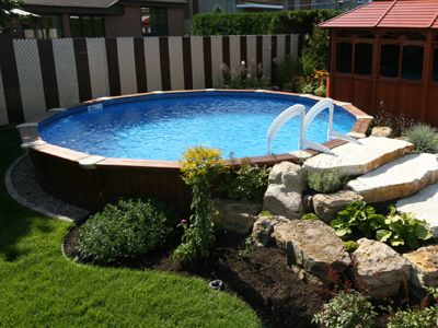 Nice semi inground pool love the natural look for Nice inground pools
