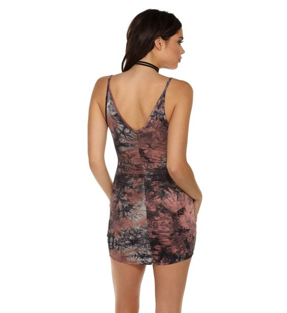 """Take it back to the good old days, but without the mess! This tie dye dress features spaghetti straps, a V neckline and a short, rounded hemline for a casual and flirty look.Lined bustAbove the kneeApprox. 21"""" side seam (Measured from under the arm to the hem of the garment.)Self 96% Rayon, 4% Spandex Lining 100%Hand wash cold. Hang or line dry."""