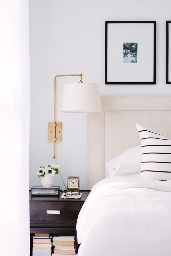 Black and white bedroom with brass swing arm lamp. #blackandwhitedecor #bedroomdecor