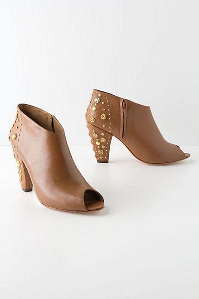 Great peep toe booties.  Riveted Shine Booties #anthropologie