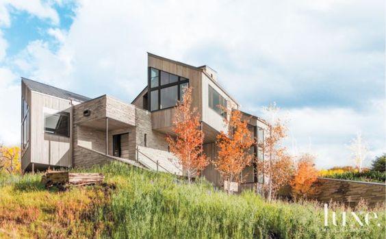 Modern Mountain Structure Utilizing Limestone and Cedar Elements