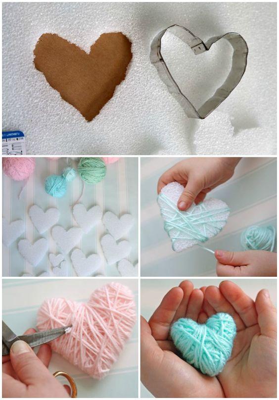 Wrap styrofoam hearts in yarn for a kid friendly Valentine's Day craft: