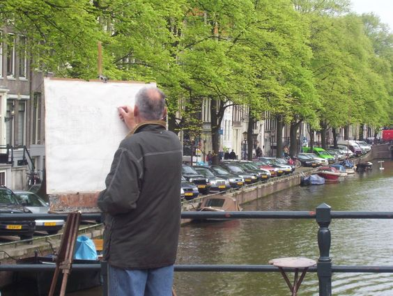 Enroute to Amsterdam's Rijksmuseum we came upon this humble artist busily working away with just a pencil in hand.