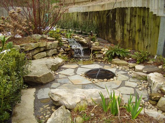 Backyard waterfall fire pit and stone seating outdoor for Waterfall seat design
