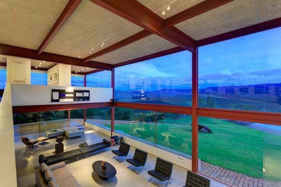 Denise Macedo #Arquitetos Associados designed a home for an art collector in Nova Lima, Brazil.