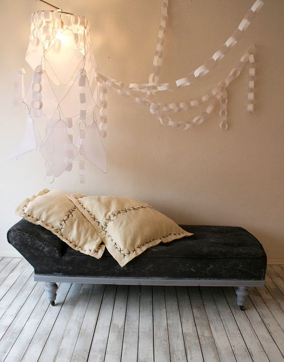 Chaise. Cool grey legs and base on casters, with a lace like fabric in dark grey.  http://www.etsy.com/listing/87334526/chaisley-jane