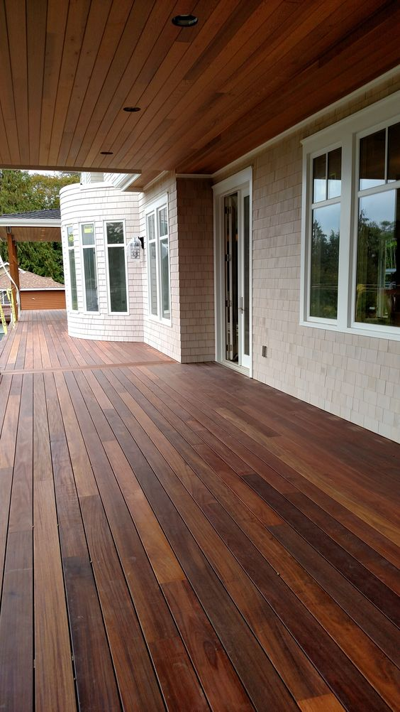 Mahogany decking applied with penofin exotic hardwood for Exterior timber decking