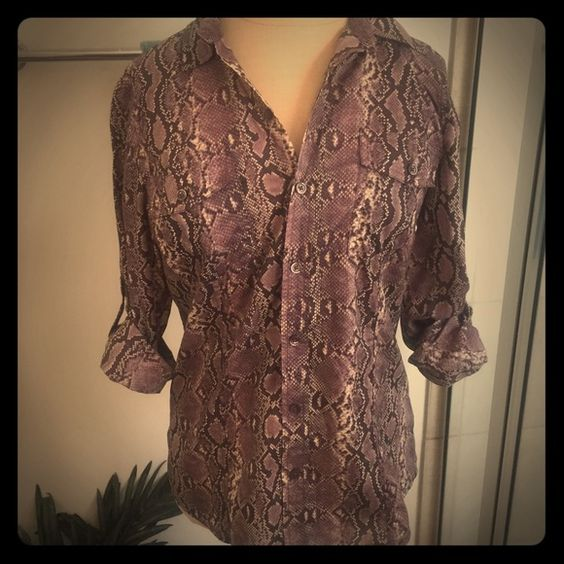 Michael Michael Kors Purple Snakeprint Blouse Michael Michael Kors Purple Snakeprint Blouse. Button front. Has button pocket on front. Shows no signs of wear. Sleeves can be rolled or worn down. Love it? Make an offer! MICHAEL Michael Kors Tops Button Down Shirts