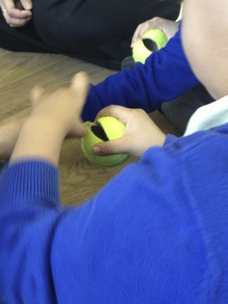 Squeezing a (pre-cut) tennis ball open and dropping a piece of pasta inside: Palm strength and pincer grip development