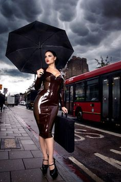 LOVE this!!! Wouldn't even need the umbrella, now would we? Not while clothed in such yummy latex! :)