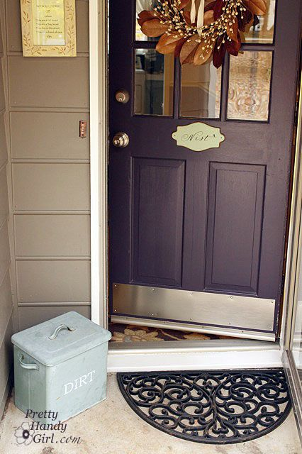 LOVE the purple door, the kickplate, the wreath.  What an inviting entry.