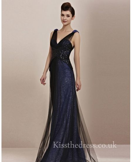 Blue and back party dress. Blue glittery floor length dress with a black over layer and black wrap around the waist :) xx
