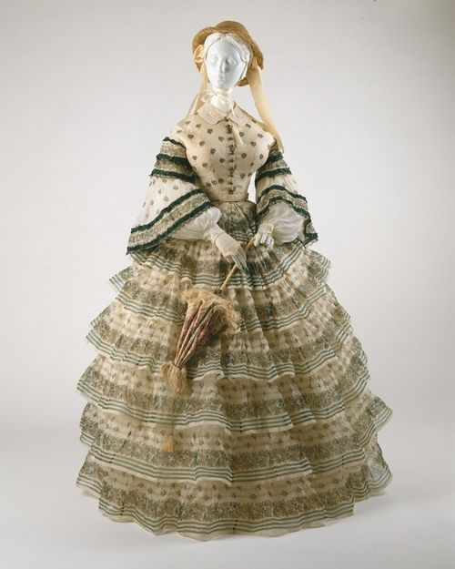 A fascinating 'ensemble' silk organza gown from 1855. It has interchangable bodices so you can wear it out and about during the day