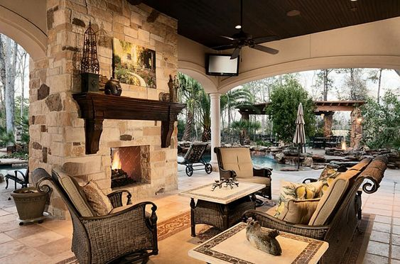 Outdoor living room with double sided fireplace for Dining room with sitting area ideas