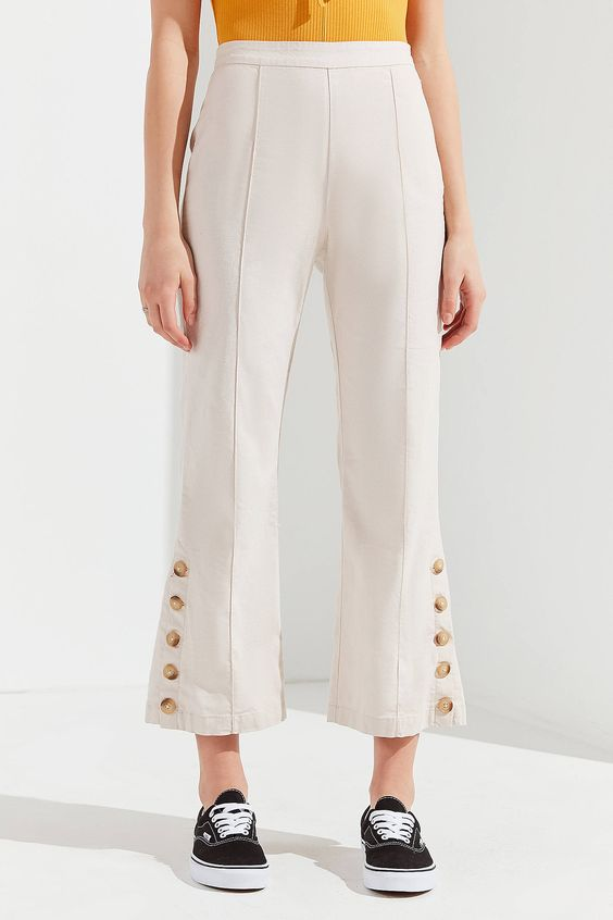 Shop UO Sandra Side-Button Cropped Flare Pant at Urban Outfitters today. We carry all the latest styles, colors and brands for you to choose from right here.