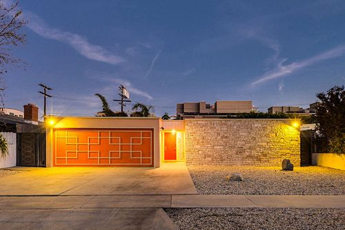 From that garage door to the exterior mosaic to the pink oven to the multicolored built-ins, this 1957 house in Marina del Rey (of all places) might not be...